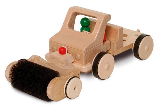 Straatveegborstel geplaatst voor de speelgoed vrachtwagen.