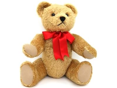 Grote Teddy beer van 50cm, in goudkleurige mohair en met een grote rode strik rond de nek.