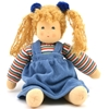 Play doll in organic cotton and wool with blond hair and blue eyes. She sits with her arms displayed on each side and wears a blue white red green striped sweatshirt and a blue gown.